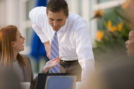 differential focus: Businesswoman and businessman talking at pavement cafe table (differential focus)