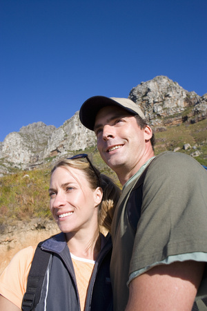 coutryside: Young couple in coutryside, smiling, low angle view