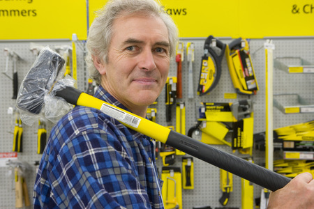 hardware store: Man with sledge hammer in hardware store, portrait LANG_EVOIMAGES