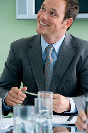 acknowledging: Businessman in meeting, smiling