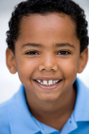 elementary age boys: Boy (7-9) smiling, close-up, front view, portrait