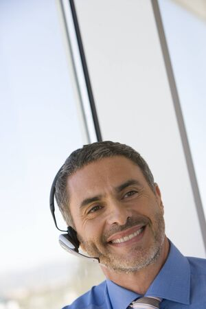 handsfree: Businessman with hands-free telephone headset LANG_EVOIMAGES