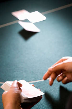 croupier: Croupier dealing cards, close-up of hands