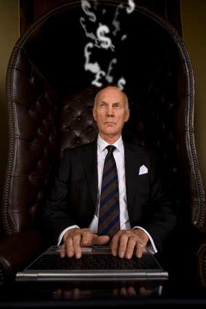 western european: Businessman typing on laptop