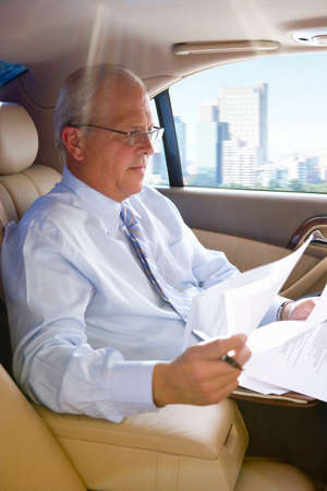 toiling: Businessman riding in town car