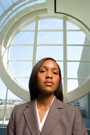 round window: Businesswoman standing in front of round window