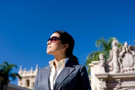 businesswoman standing: Businesswoman standing near historic building LANG_EVOIMAGES