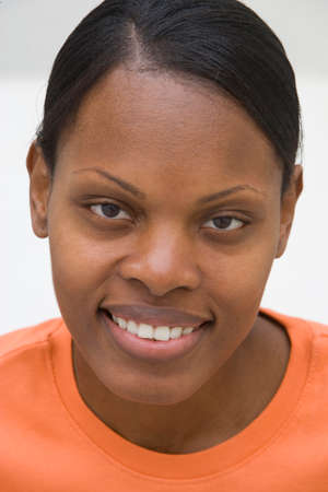 only mid adult women: Close-up of woman smiling, portrait