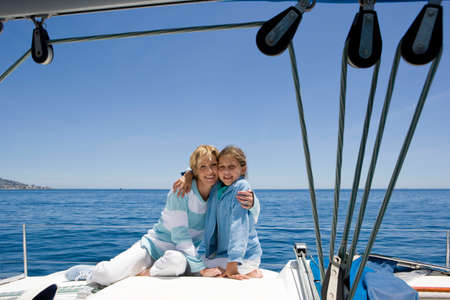 Mother and daughter on boat LANG_EVOIMAGES