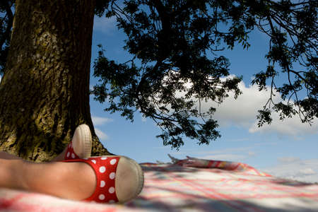 under the tree: Girl relaxing under tree