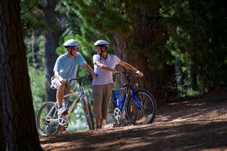 mountain biking: Couple mountain biking in woods
