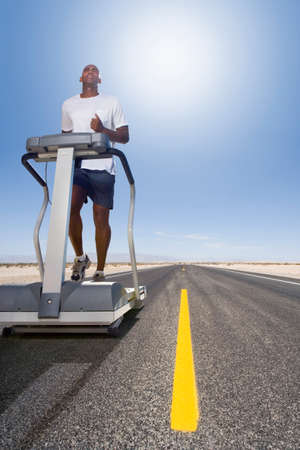 hindering: Man running on treadmill on remote desert road