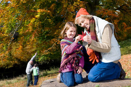 grandkids: Grandparents and grandkids exploring in woods