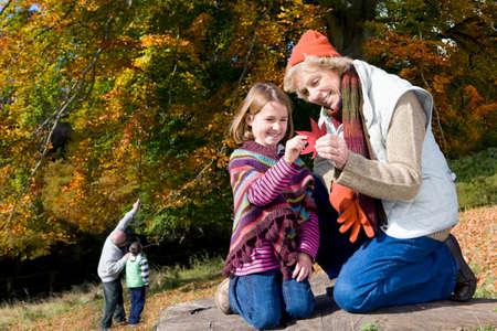 tetbury: Grandparents and grandkids exploring in woods