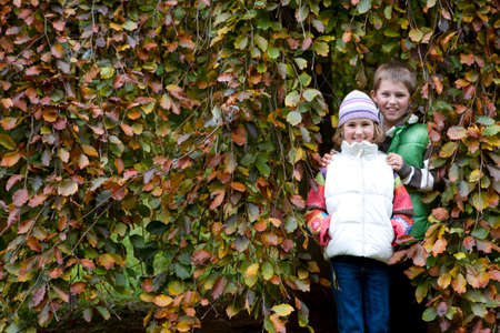 tetbury: Portrait of boy and girl standing against tree