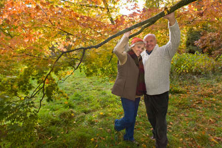 tetbury: Portrait of couple holding branch in woods LANG_EVOIMAGES