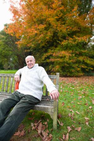 tetbury: Portrait of man sitting on bench in park