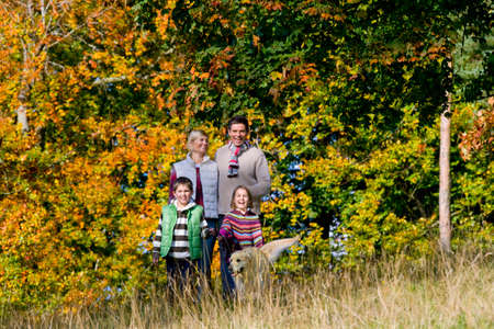 tetbury: Portrait of family and dog standing in field LANG_EVOIMAGES