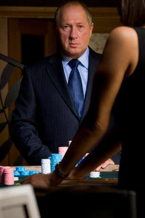 Mature man gambling, portrait