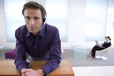 businessman waiting call: Businessman with headset, portrait