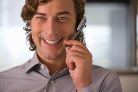 handsfree: Businessman talking on hands-free headset