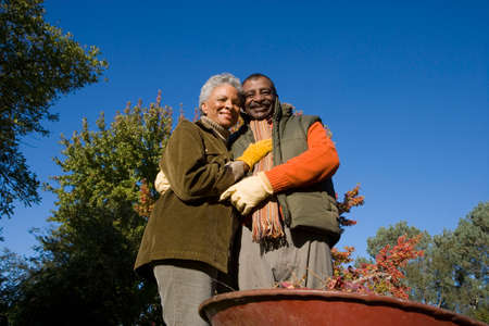 yard work: Senior couple doing yard work in autumn