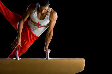 horse competition: Male gymnast performing on pommel horse LANG_EVOIMAGES