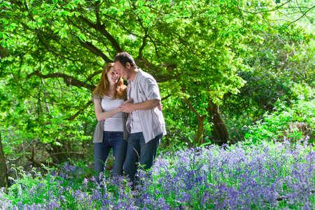 bluebell: Couple walking in field of bluebell flowers