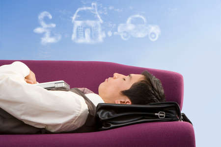 slumbering: Businessman daydreaming about success