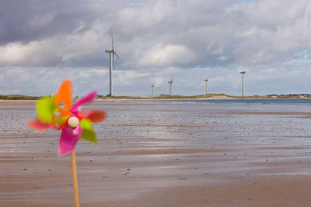 meticulous: Windmills and pinwheel on shore LANG_EVOIMAGES