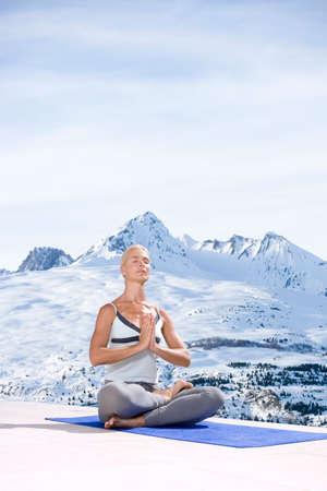 spiritualism: Woman meditating in mountains
