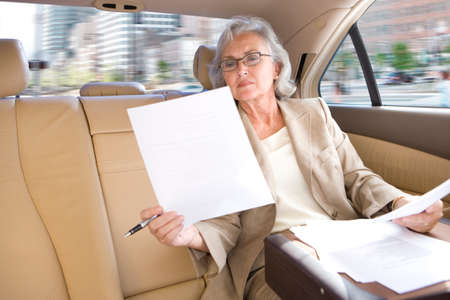 toiling: Businesswoman riding in town car