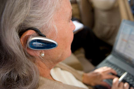 handsfree device: Businesswoman using hands-free device