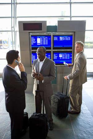north western european descent: Businessmen waiting in airport LANG_EVOIMAGES