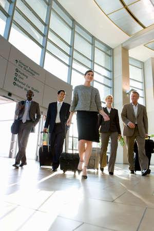 north western european descent: Businesspeople walking in airport