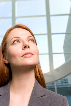 western european: Businesswoman looking up