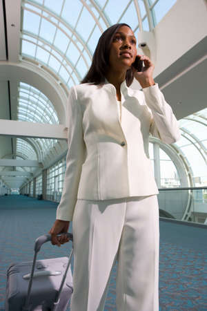 tugging: Businesswoman walking in airport