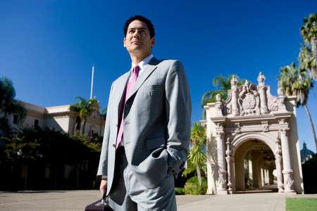 western european: Businessman standing near historic building