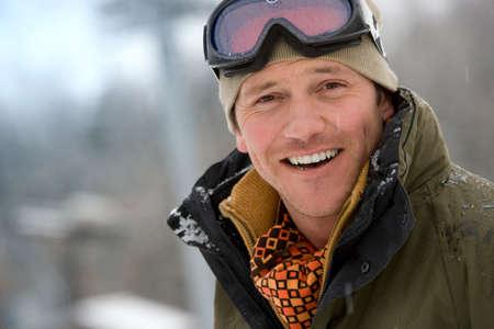 ski goggles: Mid adult man wearing ski goggles, close-up