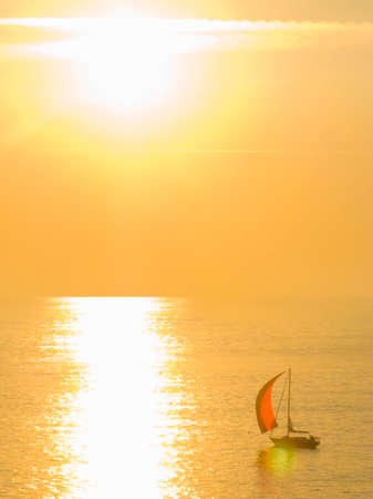 away from it all: Sailboat on tranquil sea