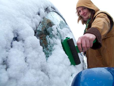 scraping: Woman scraping ice off car window