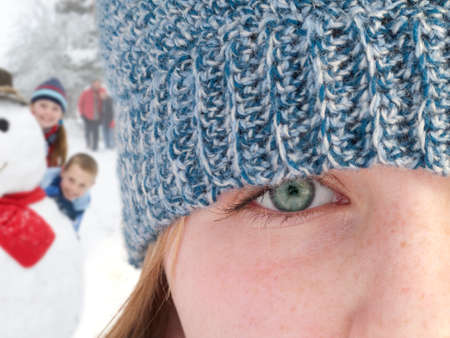 close knit: Close up of teenage girl wearing knit hat LANG_EVOIMAGES