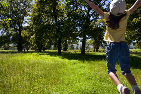 liveliness: Girl jumping in field