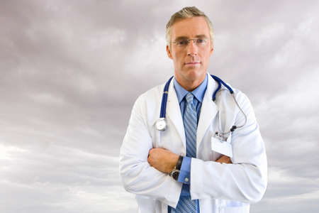 arms up: Portrait of doctor in lab coat with overcast sky in background