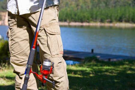 Fishing pole: Close up of man holding fishing pole