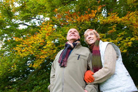 tetbury: Couple wearing scarves and standing in front of trees
