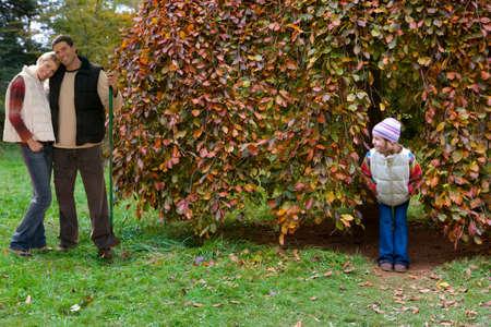 tetbury: Boy peering at girl hiding in tree LANG_EVOIMAGES