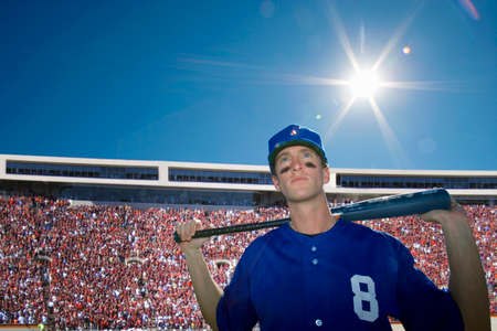 baseball crowd: Baseball player holding bat with crowd in background LANG_EVOIMAGES
