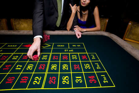 roulette table: Couple gambling at roulette table