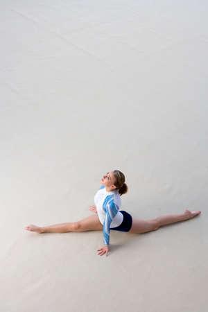 splits: Female gymnast performing splits, elevated view LANG_EVOIMAGES